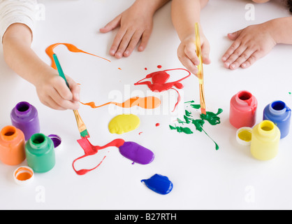 Children painting on table - Stock Photo