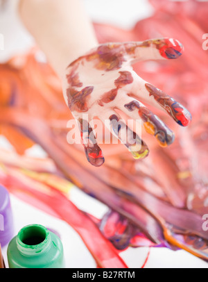 Child's hand covered in paint - Stock Photo