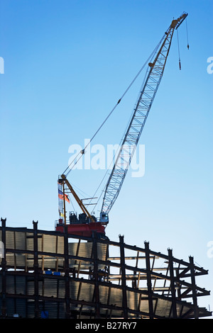 Crane on construction site, New York City, New York, United States - Stock Photo