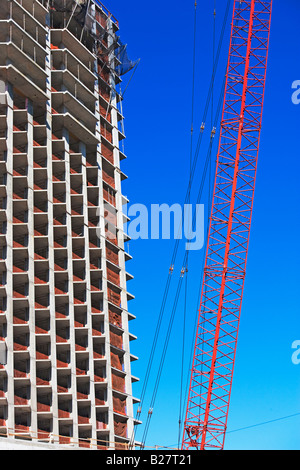 Low angle view of crane and apartment building, New York City, New York, United States - Stock Photo