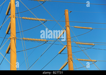 Low angle view of power lines on poles - Stock Photo