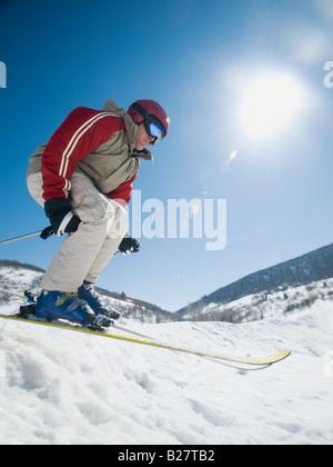 Man skiing downhill - Stock Photo