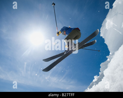 Woman on skis in air - Stock Photo