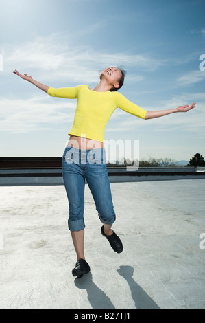 Woman with arm outstretched - Stock Photo