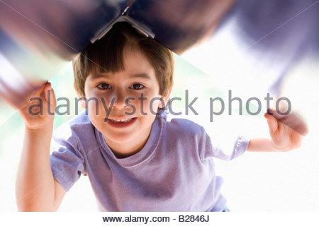 Boy (4-6) smiling, portrait - Stock Photo