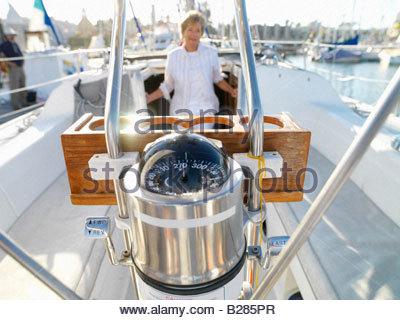 Senior woman on sailing boat, portrait - Stock Photo