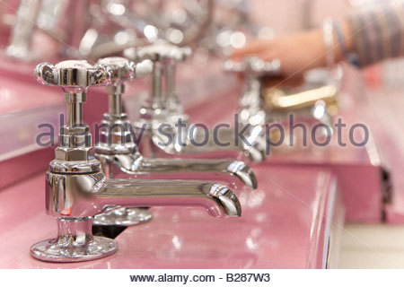 Man shopping in hardware store, close-up of hand - Stock Photo
