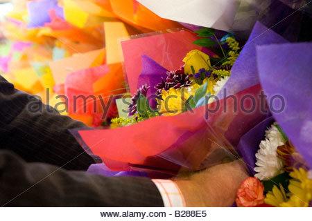 Man choosing bunch of fresh flowers - Stock Photo