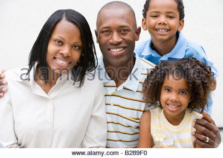 Portrait of family smiling - Stock Photo