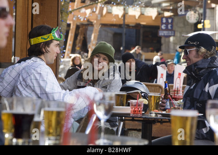 Young Adults enjoy a after ski drink Whislter Village British Columbia Canada - Stock Photo