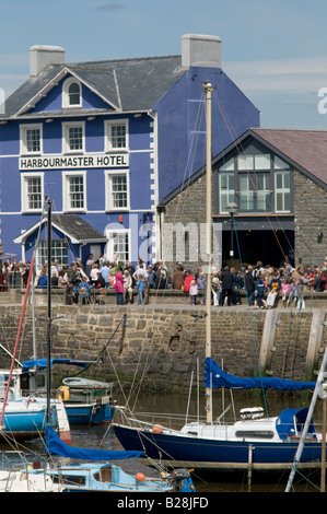 The Harbourmaster Hotel on the harbour quay, during the Cardigan Bay seafood festival Aberaeron Wales UK, summer - Stock Photo