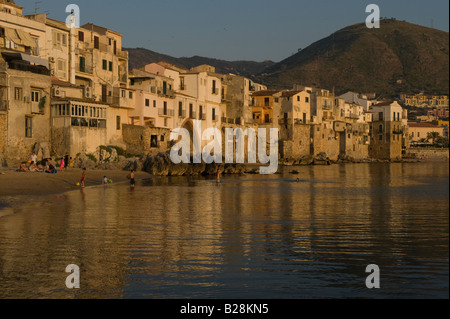 Old houses on seafront with La Rocca in background - Stock Photo