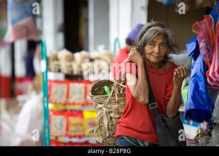 A Mangyan woman walks through the Central Market in Mansalay, Oriental Mindoro, Philippines. - Stock Photo