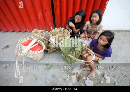 Mangyan children wait for their family members while shopping at the Central Market in Mansalay, Oriental Mindoro, - Stock Photo