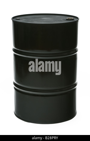 A large black oil drum or barrel standing - Stock Photo