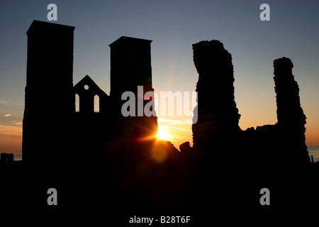 Twin towers of Reculver Church viewed from the east. A Roman fort surrounded this site. Reculver, Kent, England - Stock Photo