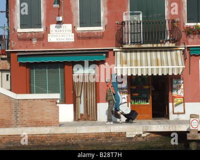 typical scene on the island of murano, venice, italy - Stock Photo