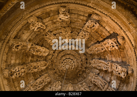 The carved sandstone DOME CEILING of the CHANDRAPRABHU JAIN TEMPLE displays carved deities inside JAISALMER FORT - Stock Photo