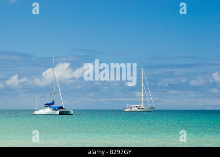 A sailboat and a catamaran anchored in Hanalei Bay which is on the north side Kauai Hanalei Bay Kauai Hawaii - Stock Photo
