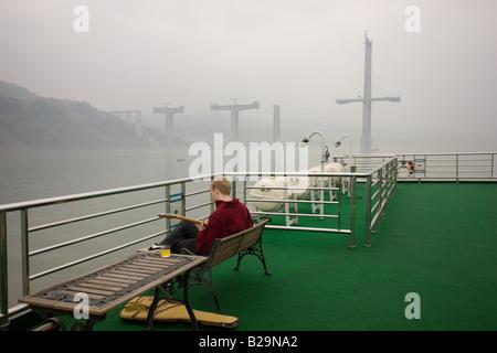 Tourist plays guitar on deck of Victoria Line Cruise Ship Yangtze River China - Stock Photo