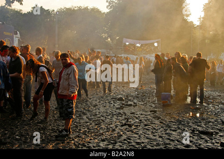techno fans in the mud during Love Parade 2008 in Dortmund Germany - Stock Photo