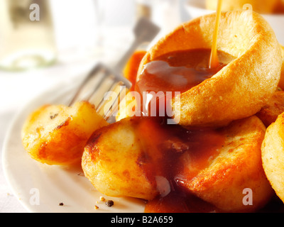 Yorkshire puddings with onion gravy - Stock Photo