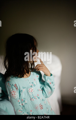 Casual portrait of girl aged five in her bedroom Mixed race indian ethnic and caucasian - Stock Photo
