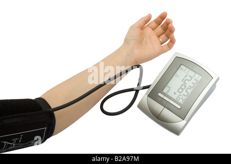 Checking the blood pressure with an electronic sphygmomanometer (blood pressure measure equipment) isolated on white - Stock Photo