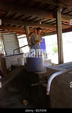 Mezcal Factory Nr Oaxaca, Mexico. Distilling the Raw Liquor to Make Mezcal - Stock Photo