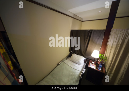 Semi-private room for sleeping in the terminal of Hong Kong International Airport. - Stock Photo