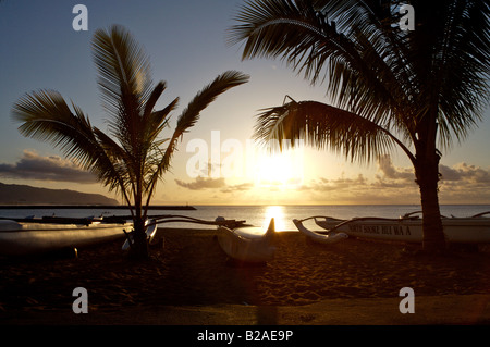 Outrigger Canoes at Sunset on the North Shore of Oahu Hawaii USA - Stock Photo