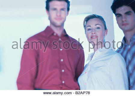 Portrait, businesswoman and two businessmen, casually dressed - Stock Photo