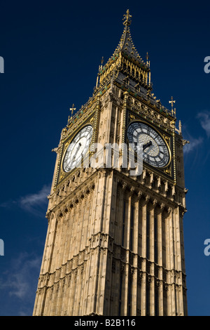 The clock tower of the Houses of Parliament, better known as Big Ben, in early morning sunshine - Stock Photo