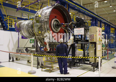 Enginer works on a Rolls Royce jet engine in the production factory Derbyshire United Kingdom - Stock Photo