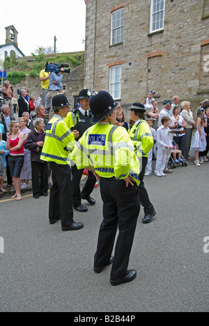 police officers on duty at helston flora day,cornwall,uk, taking a break during the dancing. - Stock Photo