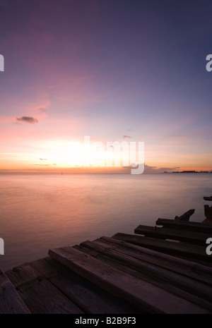 Beautiful Caribbean sunset from the wooden wharf at St.Michael, Barbados - Stock Photo