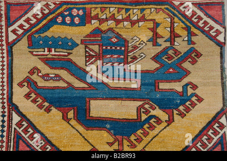 Detail of an old Ottoman rug displayed inside the Islamic section of Pergamon Museum in Museumsinsel island in Berlin - Stock Photo