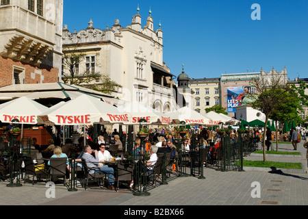 Street cafe in front of the Draper's Hall, Sukiennice, on Krakow Market Square, Rynek, UNESCO World Heritage Site, - Stock Photo