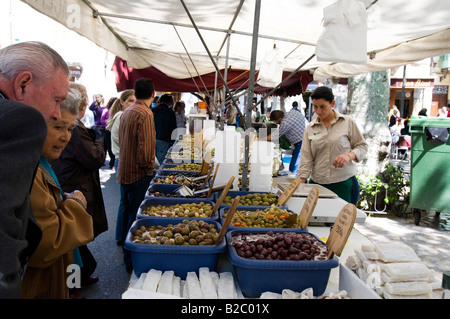 Market stall with olives and other spicy ingredients, Soller, Mallorca, the Balearic Islands, Spain, Europe - Stock Photo