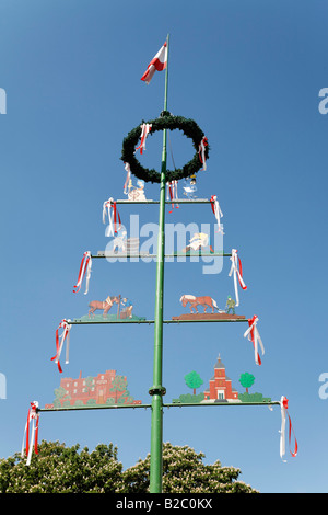 May pole decorated with a wreath and symbols, Krefeld-Linn, Lower Rhineland, North Rhine Westphalia, Germany, Europe - Stock Photo