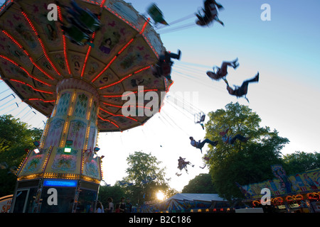 Chair-O-Planes or swing carousel amusement ride at the traditional Waeldchestag celebration, Frankfurt, Hesse, Germany, - Stock Photo