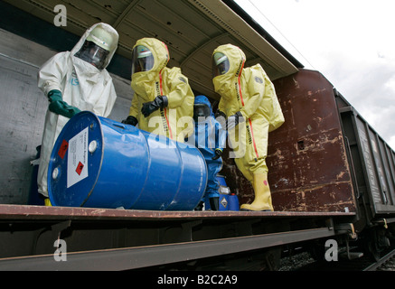 Firemen wearing hazmat suits at work during a disaster control drill, near Poing, Bavaria, Germany, Europe - Stock Photo
