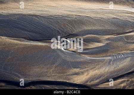 Patterns in the sand from flowing water, beach, Atlantic - Stock Photo