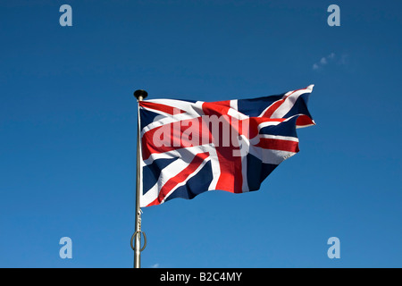Union Jack, English Flag, Flag of Great Britain, fluttering in the wind on a flagpole - Stock Photo