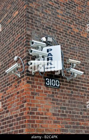 CCTV Security cameras on a street corner in Harlem, Manhattan, New York City, USA - Stock Photo