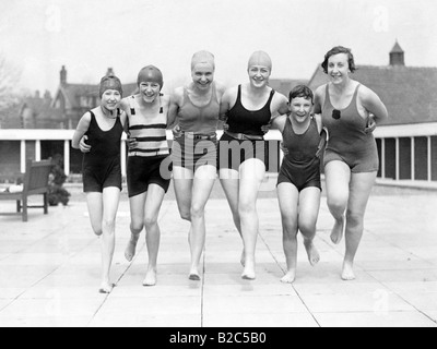 Group of women in bathing costumes on a landing stage, historical photo, circa 1920 - Stock Photo