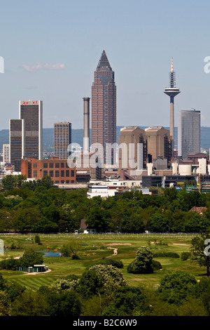 Skyline of Frankfurt, Messeturm Tower, horse track and Niederrad Golf Course in foreground, Frankfurt, Hesse, Germany, - Stock Photo