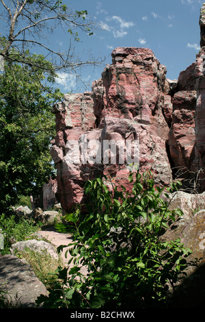 Rock outcrop along trail Pipestone National Monument Pipestone Minnesota. The rock is quartzite from Sioux quartzite - Stock Photo