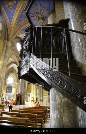 Carved wooden stairway leading to pulpit in Santa Maria sopra Minerva Rome. - Stock Photo