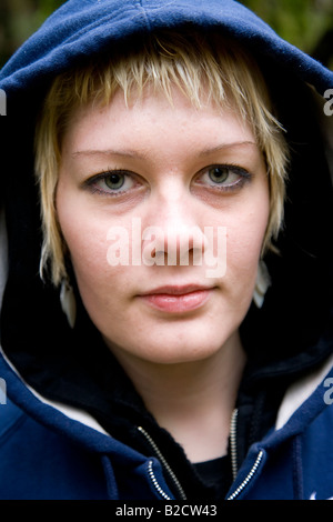 Beautiful young blond woman in a hood - Stock Photo